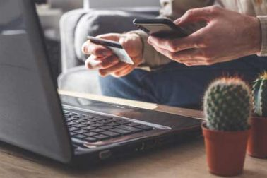 online-payment-with-smartphone-or-laptop-W5MA39P